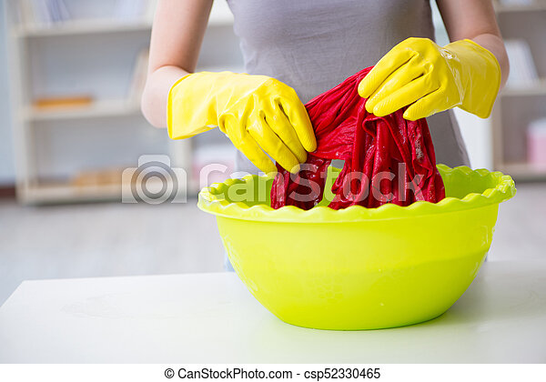 Woman doing cleaning at home - csp52330465