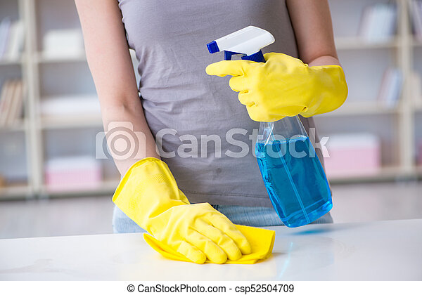 Woman doing cleaning at home - csp52504709