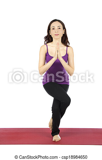 woman doing eagle pose in yoga woman is doing eagle pose