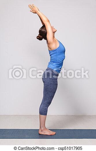 woman doing hatha yoga asana tadasana  mountain pose with