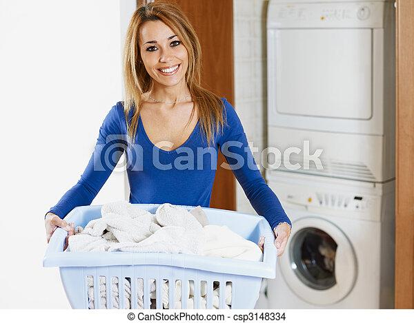 woman doing laundry - csp3148334