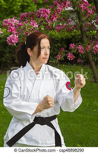 woman doing martial art - csp48898290