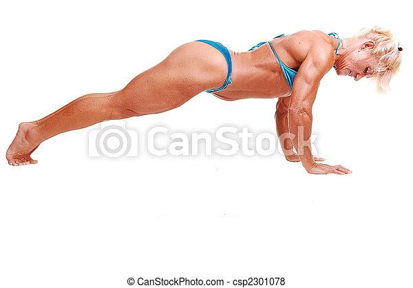 Woman doing pushups. - csp2301078