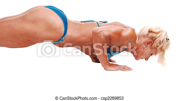 Woman doing pushups. - csp2289853