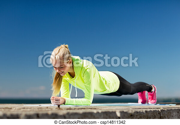 woman doing sports outdoors - csp14811342