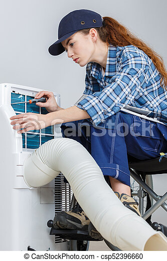 woman doing the maintenance of air-conditioning - csp52396660