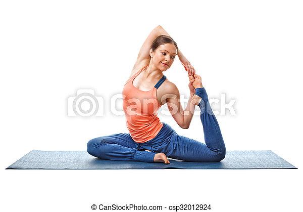 woman doing yoga asana eka pada kapotasana sporty fit