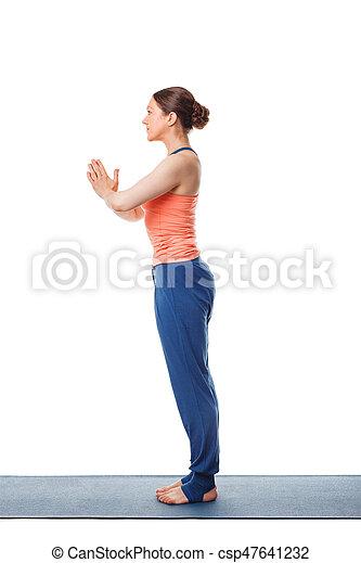 woman doing yoga asana tadasana namaste  mountain pose