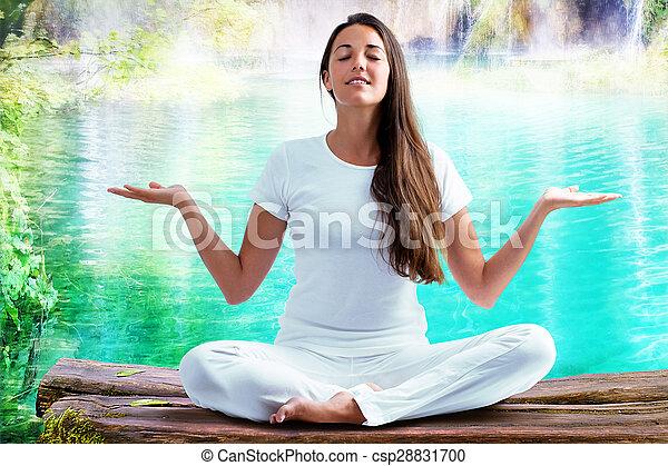 Woman doing yoga exercise at lake. - csp28831700
