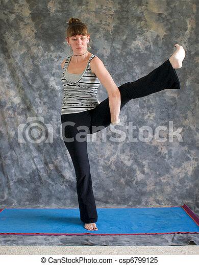 woman doing yoga posture bird of paradise pose or