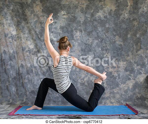 woman doing yoga posture king arthurs pose variation