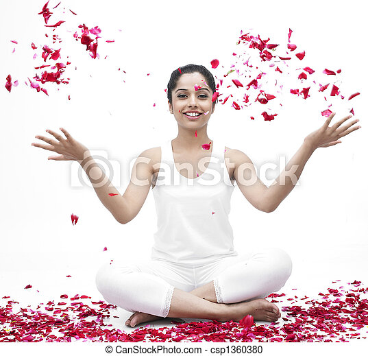 woman doing yoga with pelas flying - csp1360380