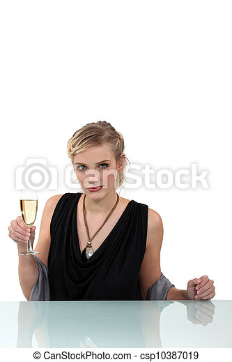 Woman drinking a glass of champagne - csp10387019
