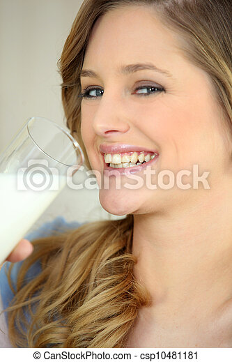 Woman drinking a glass of milk - csp10481181