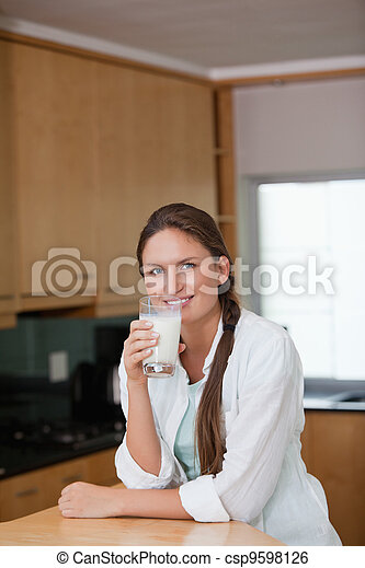 Woman drinking a glass of milk - csp9598126