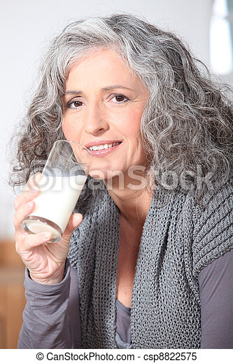 Woman drinking a glass of milk - csp8822575