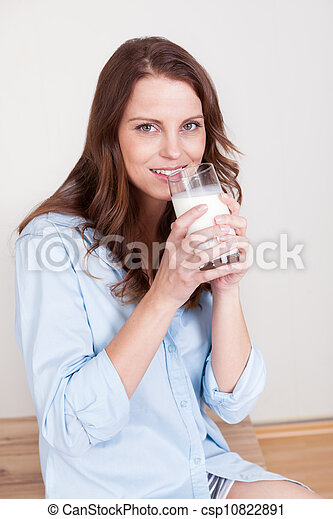 Woman drinking a glass of milk - csp10822891