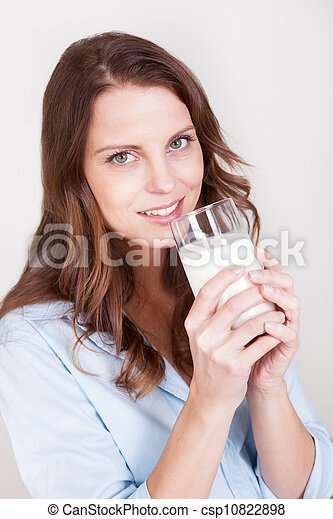 Woman drinking a glass of milk - csp10822898