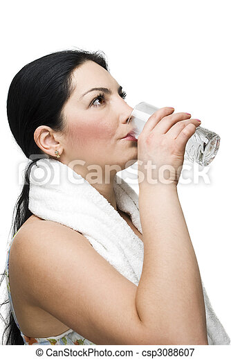 Woman drinking a glass of water - csp3088607
