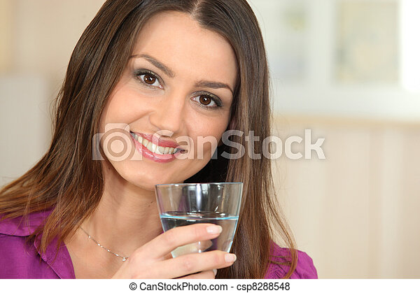 Woman drinking a glass of water - csp8288548