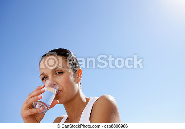 Woman drinking a glass of water - csp8806966
