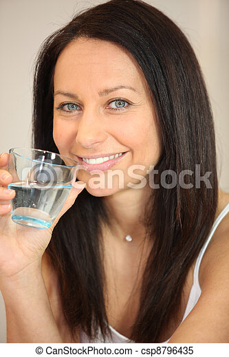 Woman drinking a glass of water - csp8796435