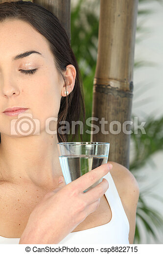 Woman drinking a glass of water - csp8822715