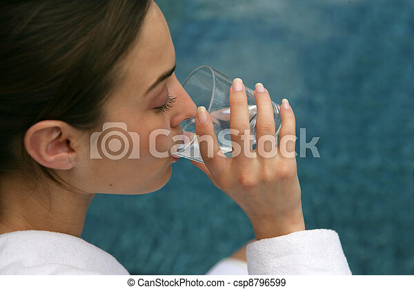 Woman drinking a glass of water - csp8796599