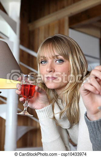 Woman drinking a glass of wine - csp10433974