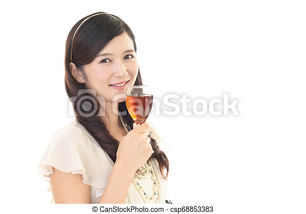 Woman drinking a glass of wine - csp68853383