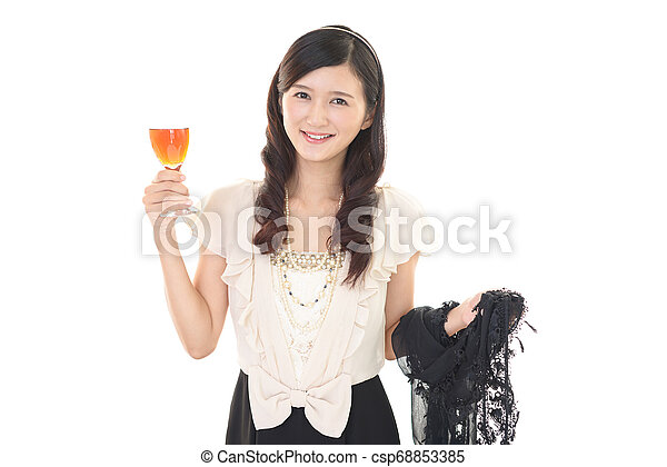 Woman drinking a glass of wine - csp68853385