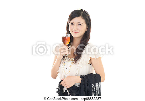 Woman drinking a glass of wine - csp68853387