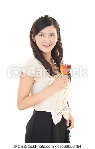 Woman drinking a glass of wine - csp68853464