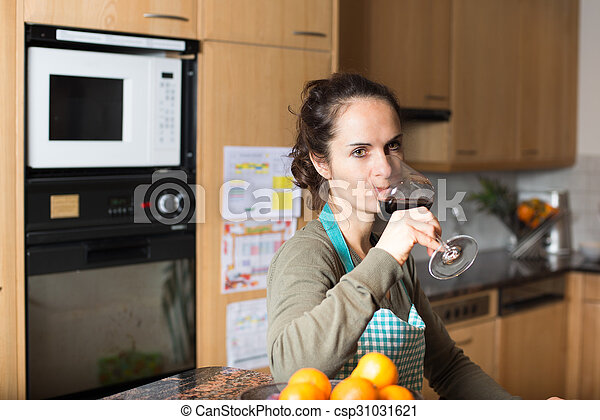 Woman drinking a glass of wine - csp31031621