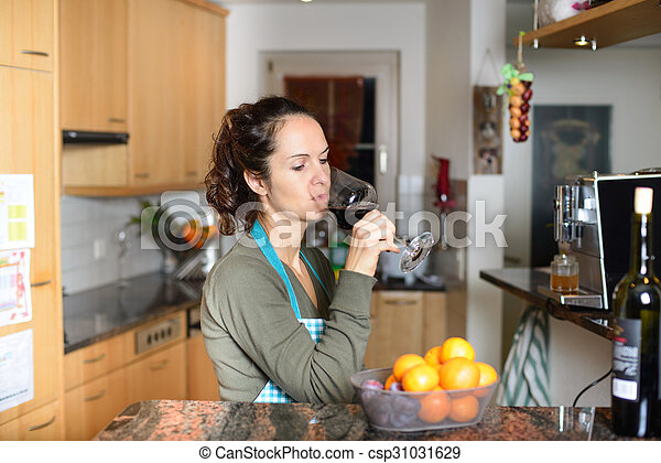 Woman drinking a glass of wine - csp31031629