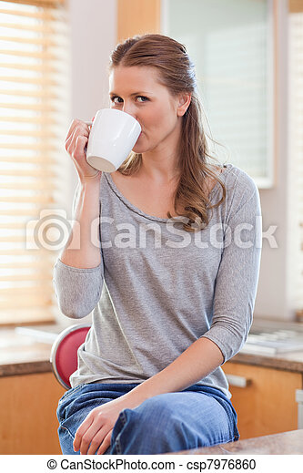 Woman drinking coffee in the kitchen - csp7976860