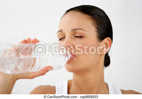 Woman drinking from a bottle of water - csp8806933
