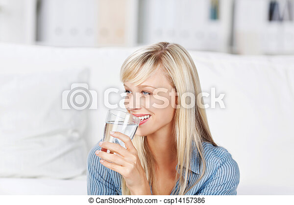 Woman drinking mineral water - csp14157386