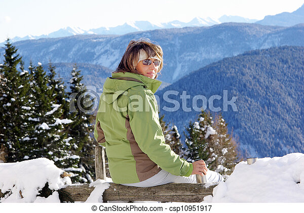 woman drinking on the alps - csp10951917