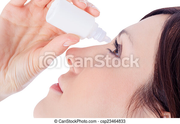 woman dripping eye with eyes drops - csp23464833