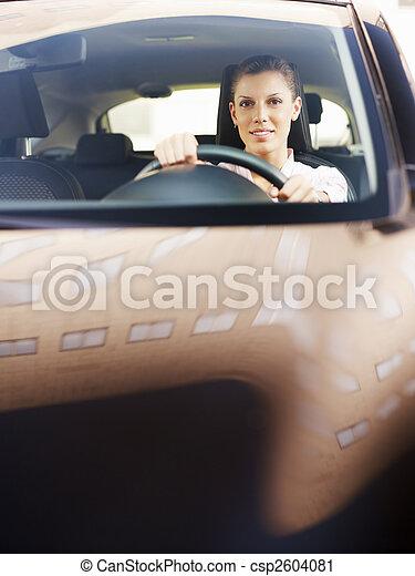 woman driving car - csp2604081