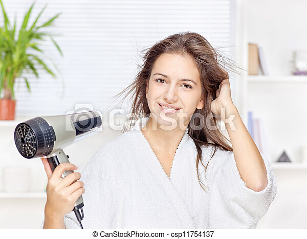 Woman drying hair at home - csp11754137