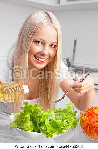 woman eating salad - csp44753366