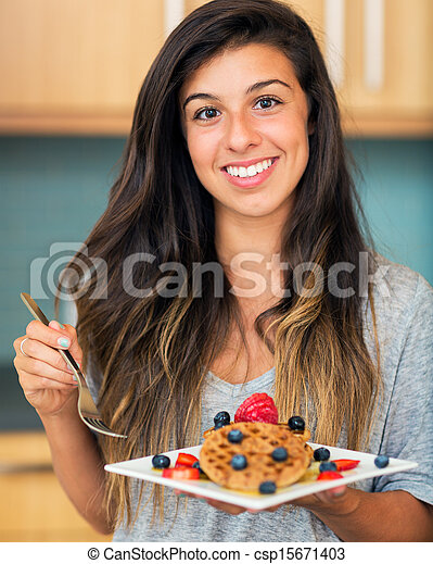 Woman eating Waffles with Fresh Fruit - csp15671403