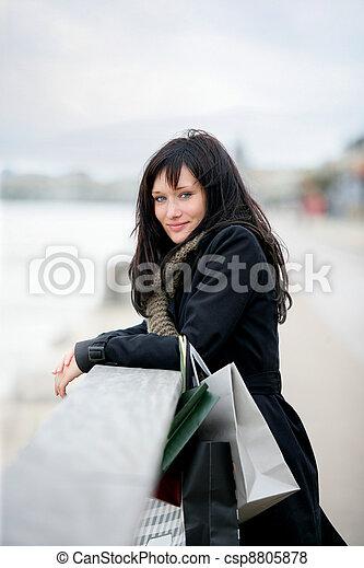 Woman enjoying shopping trip - csp8805878