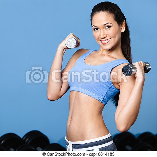 Woman exercises with dumbbells - csp10814183