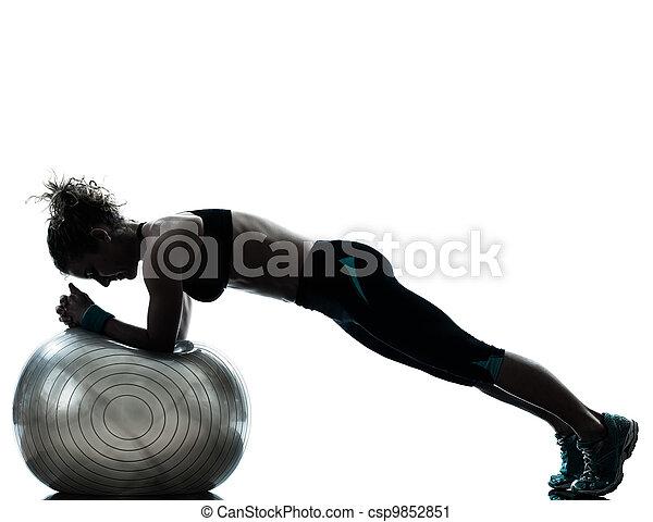 woman exercising fitness ball workout   - csp9852851