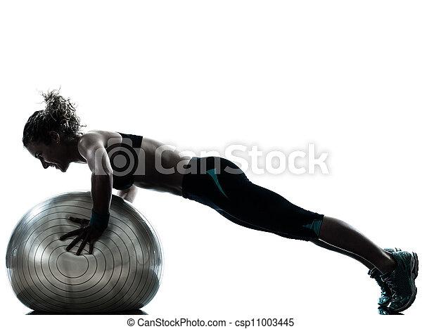 woman exercising fitness ball workout   - csp11003445