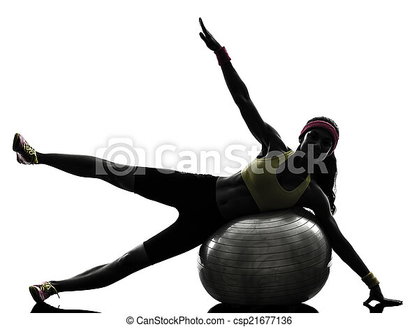 woman exercising fitness ball workout  silhouette - csp21677136