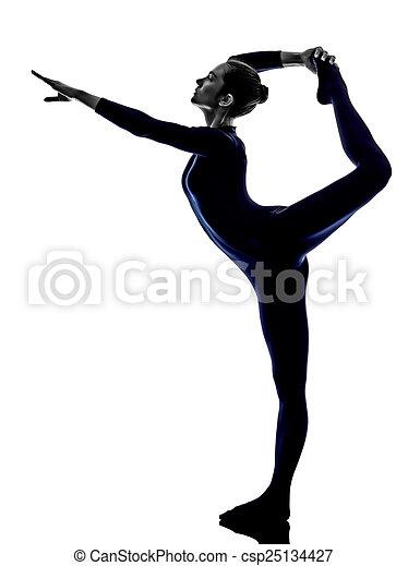 woman exercising Natarajasana dancer pose yoga silhouette - csp25134427